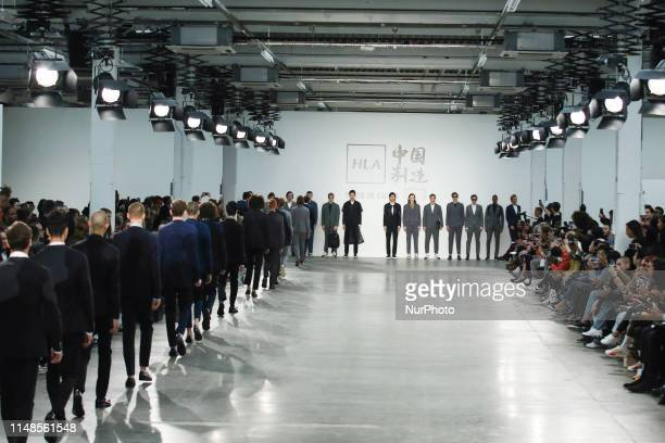 Models present a new Spring/Summer 2020 HLA x AEX by JD.COM collection during London Fashion Weak Mens in the old Trumans Brewery show space in...