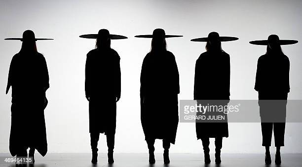 NAME Models present Autumn/Winter 20142015 collection creations by Martin Lamothe during Madrid Fashion Week in Madrid on February 15 2014 AFP PHOTO...