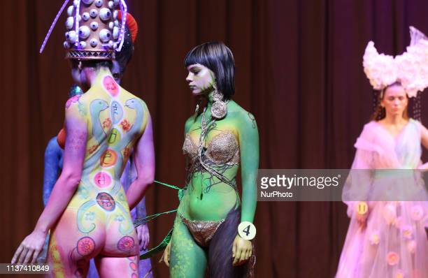 Models present body art creations during the annual international hairdressers festival 'Crystal Angel' in Kiev Ukraine 15 April 2019 Hairdressers...