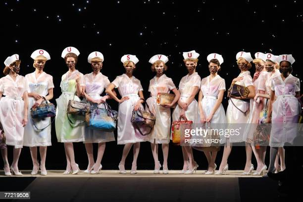 Models present creation by US designer Marc Jacobs for Louis Vuitton during Spring/Summer 2008 readytowear collection show in Paris 07 October 2007...