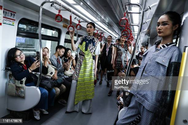 Models present creation during the fashion show in a light rail transit system in Jakarta Indonesia on August 13 2019