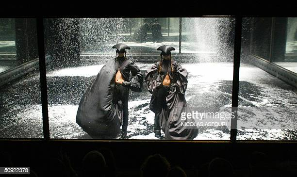 Models present creations by Alexander McQueen during the 'Black' fashion show in London 03 June 2004 The show sponsored by British designer Alexander...