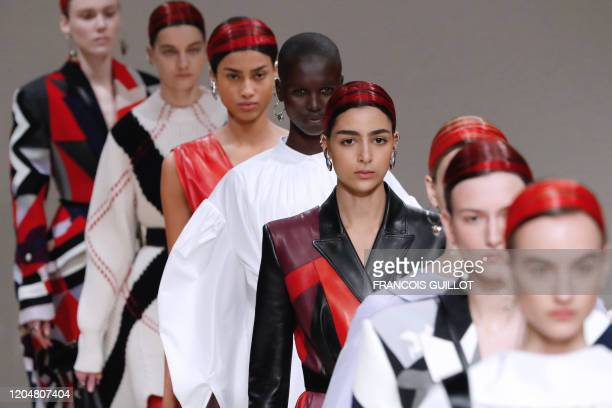 Models present creations by Alexander McQueen during the Women's Fall-Winter 2020-2021 Ready-to-Wear collection fashion show in Paris, on March 2,...