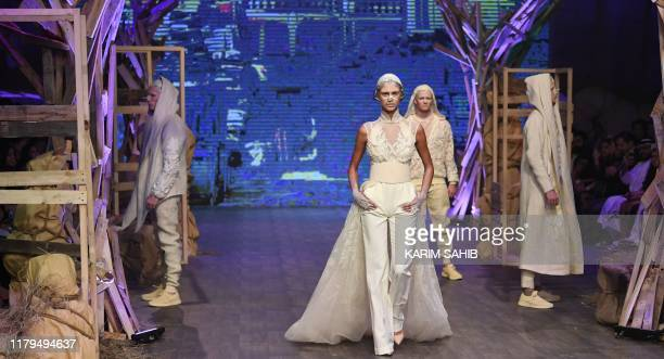 Models present creations by Amato during the Fashion Forward event at the Dubai Design District in Dubai on November 2 2019