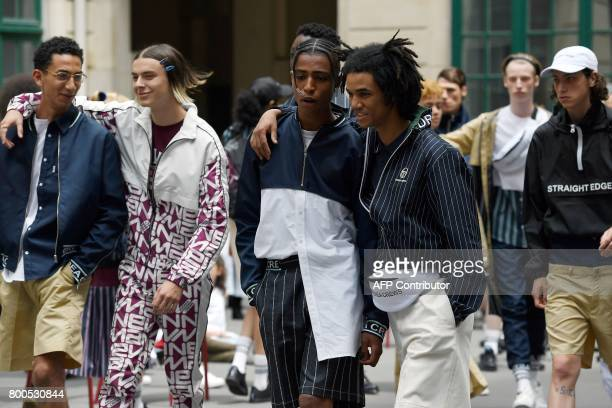 Models present creations by Andrea Crews house during men's Fashion Week for the Spring/Summer 2017/2018 collection in Paris on June 24 2017 / AFP...