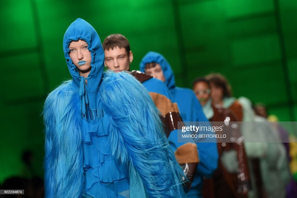 Models present creations by Annakiki during the women's Fall/Winter 2018/2019 collection fashion show in Milan, on February 21, 2018. / AFP PHOTO / Marco BERTORELLO