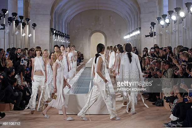 Models present creations by Balenciaga during the 2016 Spring/Summer readytowear collection fashion show on October 2 2015 in Paris AFP PHOTO /...