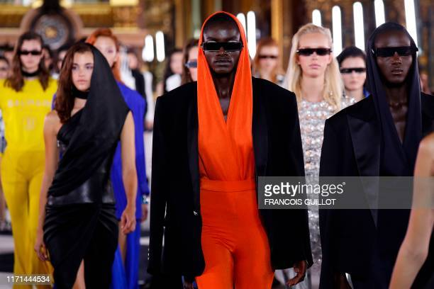 TOPSHOT Models present creations by Balmain during the Women's SpringSummer 2020 ReadytoWear collection fashion show at Opera Garnier in Paris on...