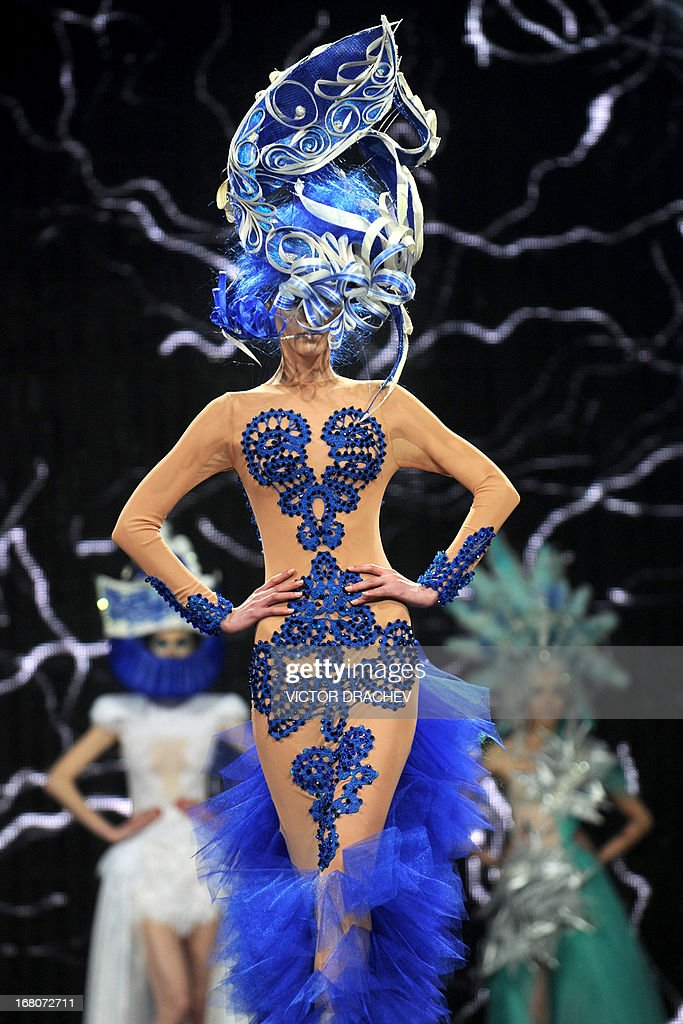 Models present creations by Belarus' designer Aleksei Kirilyuk during the annual international festival Mill of Fashion in Minsk on May 4, 2013.