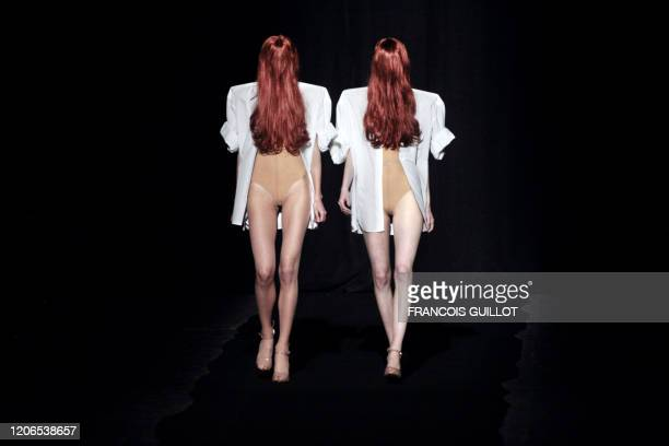 Models present creations by Belgian deisgner Martin Margiela during the spring/summer 2009 ready-to-wear collection show in Paris, on September 29,...