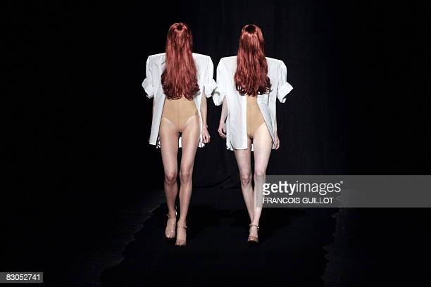 Models present creations by Belgian designer Martin Margiela during the spring/summer 2009 ready-to-wear collection show in Paris, on September 29,...
