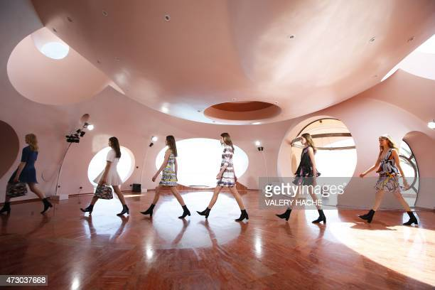 Models present creations by Belgian fashion designer Raf Simons during the Dior 2016 cruise collection show, on May 11, 2015 at the Palais Bulle in...
