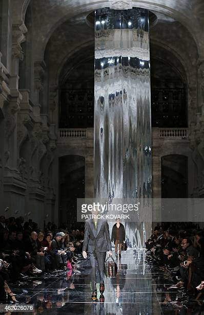Models present creations by Berluti during the men's Fall/Winter 2015 readytowear collection fashion show in Paris on January 23 2015