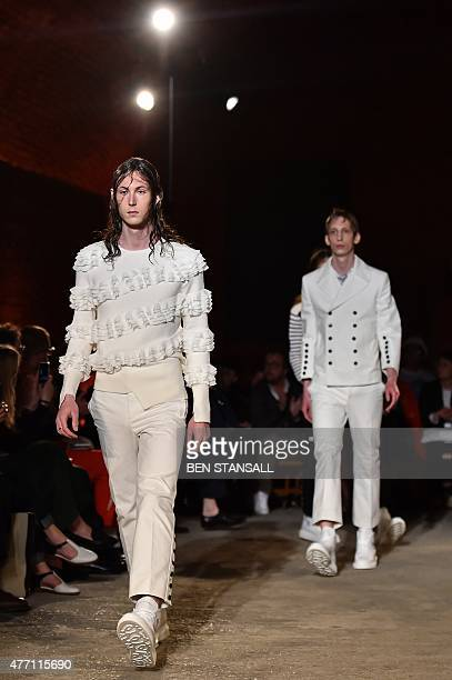 Models present creations by British designer Alexander McQueen on the third day of the Spring/Summer 2016 London Collections Men fashion event in...