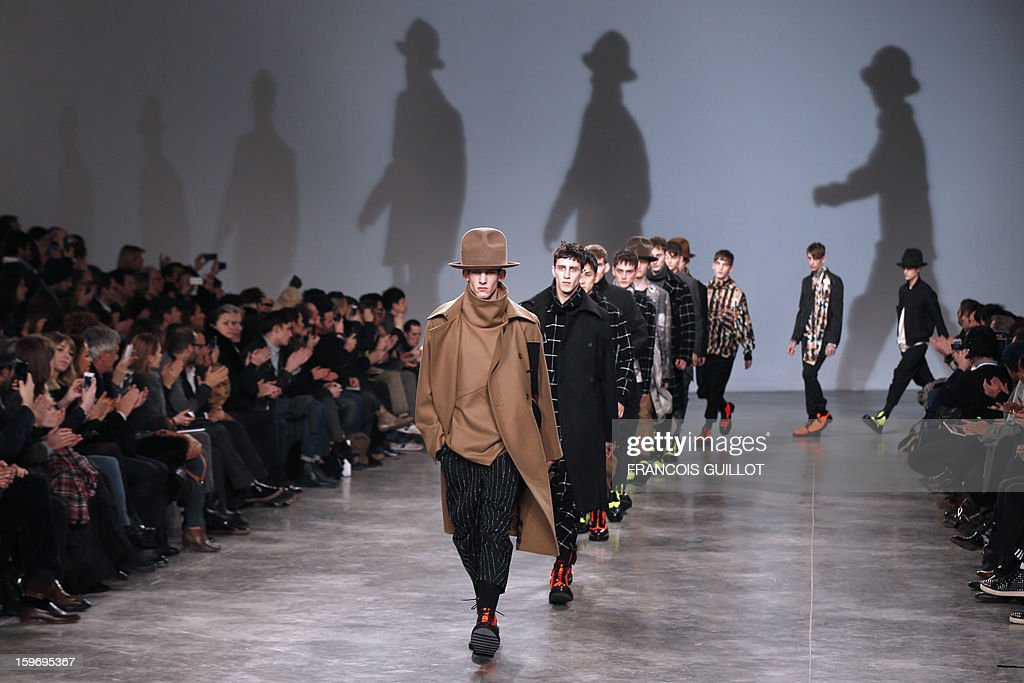 Models present creations by British designer Bill Gaytten for the label John Galliano during the men's Fall-Winter 2013-2014 collection show on January 18, 2013 as part of the Men's fashion week in...