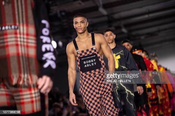 Models present creations by British designer Bobby Abley on the opening day of the Autumn/Winter 2019 London Fashion Week Men's fashion event in...