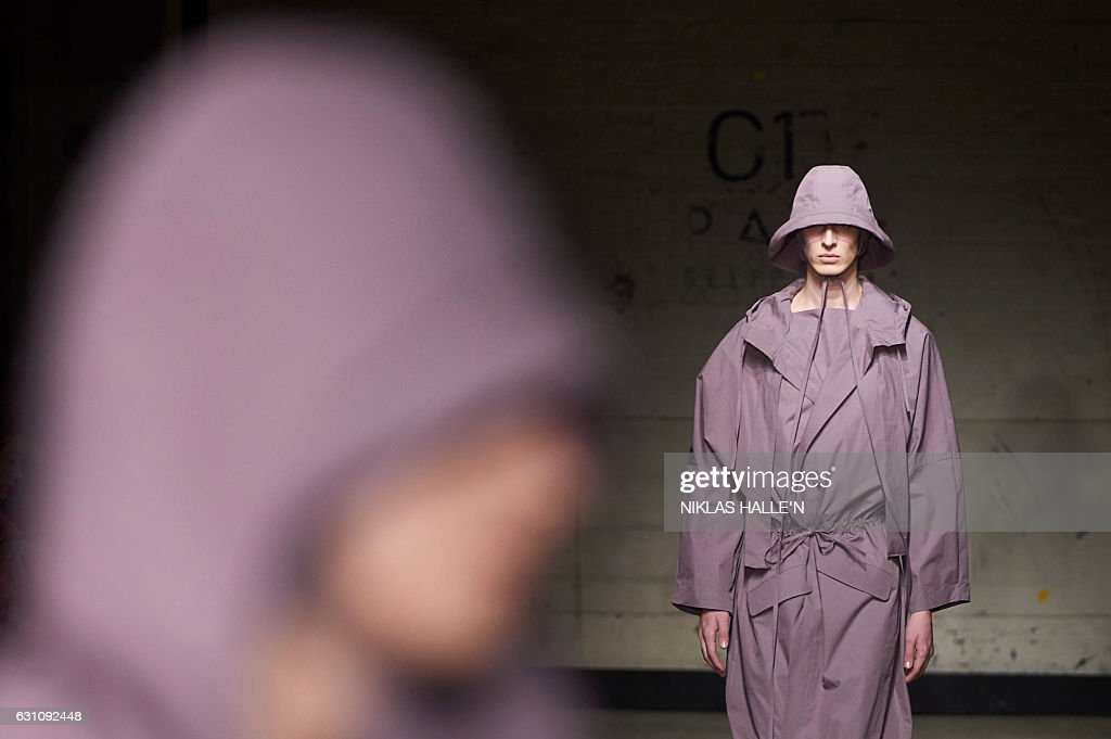 Models present creations by British designer Craig Green on the first day of the Autumn/Winter 2017 London Fashion Week Men's fashion event in London on January 6, 2017. / AFP / NIKLAS HALLE'N