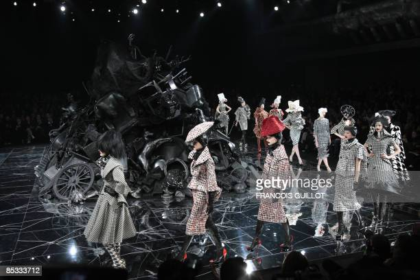 Models present creations by Britishn designer Alexander McQueen during the autumn/winter 2009 readytowear collection show in Paris on March 10 2009...