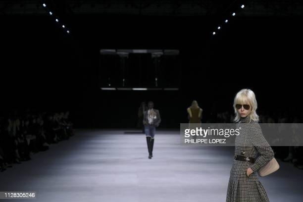 Models present creations by Celine during the Women's FallWinter 2019/2020 ReadytoWear collection fashion show in Paris on March 1 2019