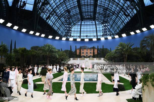 TOPSHOT Models present creations by Chanel at the end of the 2019 SpringSummer Haute Couture collection fashion show at the Grand Palais in Paris on...