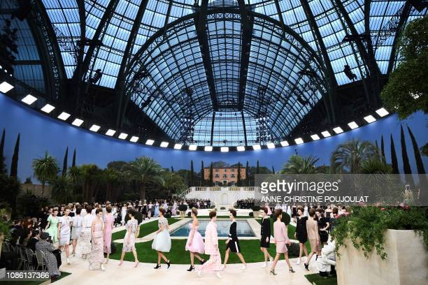 Models present creations by Chanel at the end of the 2019 SpringSummer Haute Couture collection fashion show at the Grand Palais in Paris on January...