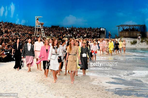 TOPSHOT Models present creations by Chanel at the end of the SpringSummer 2019 ReadytoWear collection fashion show at the Grand Palais in Paris on...
