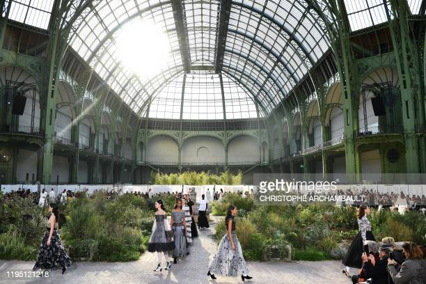 Models present creations by Chanel at the end of the Women's Spring-Summer 2020/2021 Haute Couture collection fashion show at the Grand Palais in...