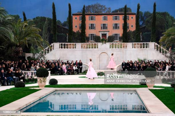 TOPSHOT Models present creations by Chanel during the 2019 SpringSummer Haute Couture collection fashion show at the Grand Palais in Paris on January...