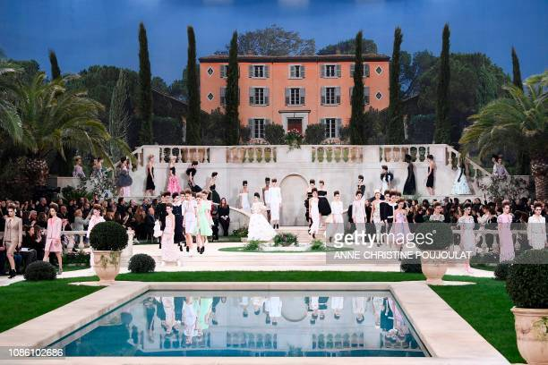 Models present creations by Chanel during the 2019 Spring-Summer Haute Couture collection fashion show at the Grand Palais in Paris, on January 22,...