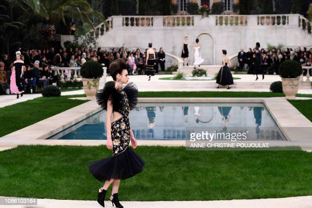 Models present creations by Chanel during the 2019 SpringSummer Haute Couture collection fashion show at the Grand Palais in Paris on January 22 2019
