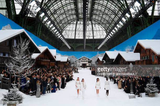 Models present creations by Chanel during the Women's Fall-Winter 2019/2020 Ready-to-Wear collection fashion show at the Grand Palais turned into a...
