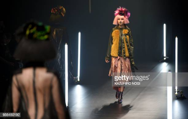 Models present creations by Chineseborn designer Viviano Sue for his 2018 autumn/winter collection at Tokyo Fashion Week in Tokyo on March 21 2018 /...
