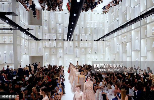 Models present creations by Christian Dior at the end of the 20182019 Fall/Winter Haute Couture collection fashion show in Paris on July 2 2018