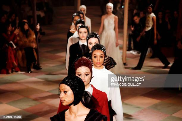 Models present creations by Christian Dior at the end of the 2019 Spring-Summer Haute Couture collection fashion show in Paris, on January 21, 2019.