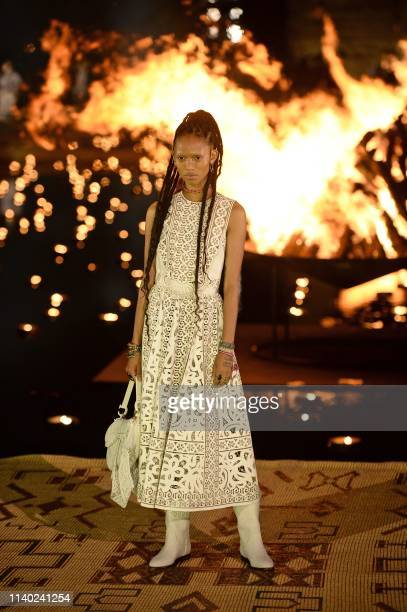 Models present creations by Christian Dior during the Croisiere 2020 collection fashion show at Badi palace in the Moroccan city of Marrakesh on...