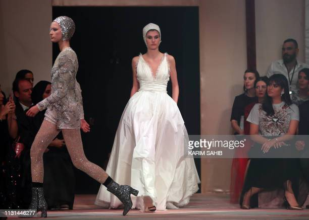 Models present creations by Christian Dior during the Haute Couture Spring-Summer 2019 collection fashion show in the emirate of Dubai on March 18,...