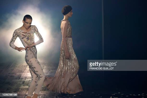 Models present creations by Christian Dior during the Spring-Summer 2019 Ready-to-Wear collection fashion show in Paris, on September 24, 2018.