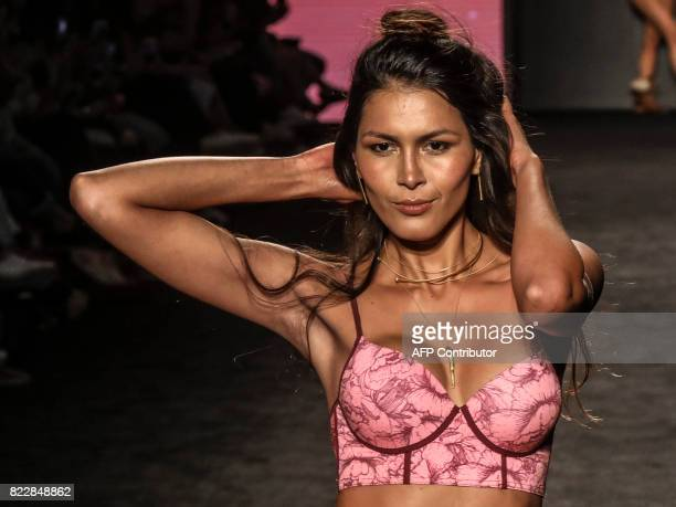 Models present creations by Colombian designer Leonisa at Colombiamoda during Medellin's fashion week in Medellin Antioquia department Colombia on...