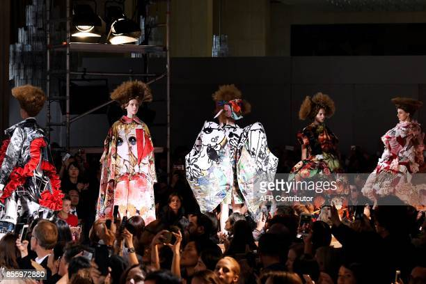 Models present creations by Comme des garcons during the women's 2018 Spring/Summer readytowear collection fashion show in Paris on September 30 2017...