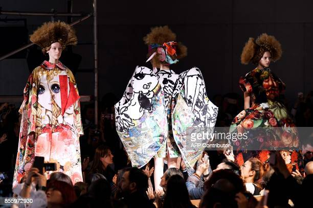Models present creations by Comme des garcons, during the women's 2018 Spring/Summer ready-to-wear collection fashion show in Paris, on September 30,...