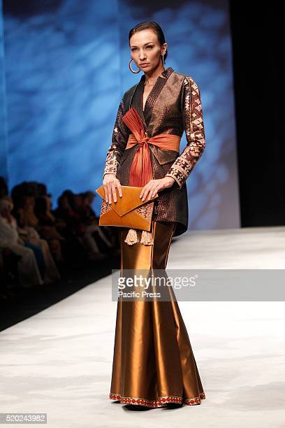 Models present creations by Defrico Audi during the Indonesia Fashion Week Indonesia Fashion Week theme is Reflections of Culture as local culture...