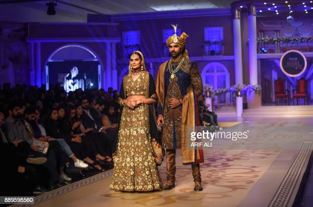 Models present creations by designer Ahsan on the last day of the Pantene Hum Bridal Couture Week in Lahore on December 10 2017 / AFP PHOTO / ARIF ALI