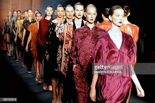 Models present creations by designer Patachou during first day of the Rio Fashion Week Winter 2012 collection at the Pier Maua in Rio de Janeiro...