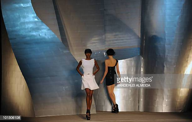 Models present creations by designer Patachou during the Rio Fashion Week Summer 2010/2011 collection at the Pier Maua in Rio de Janeiro Brazi lon...