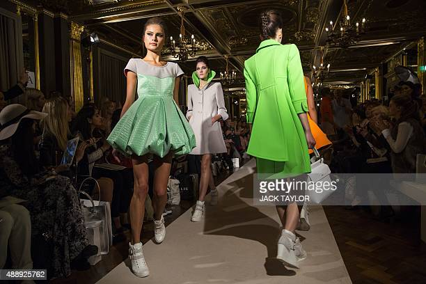 Models present creations by designer Paul Costelloe during their 2016 spring / summer catwalk show at London Fashion Week in London on September 18...
