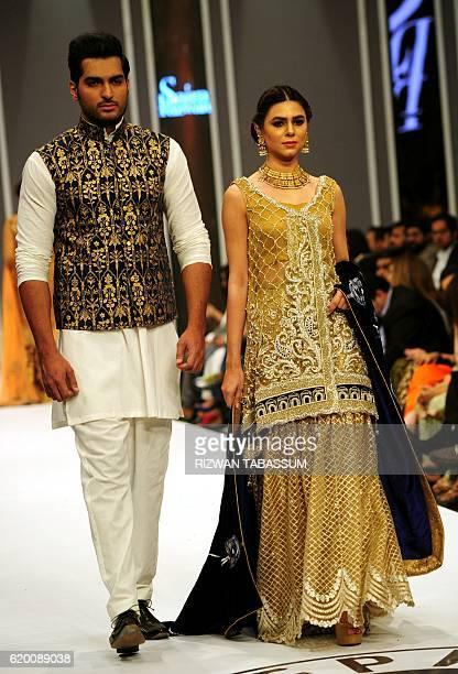 Models present creations by designer Saira Rizwan at the Fashion Pakistan Week Winter Festive 2016 in Karachi on November 1 2016 / AFP / Rizwan...