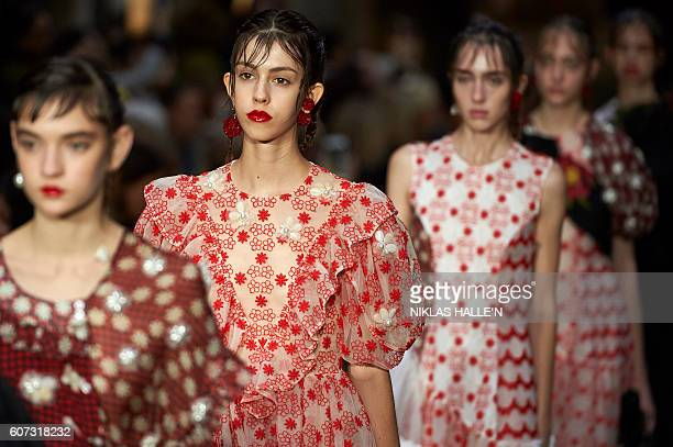 Models present creations by designer Simone Rocha during the 2017 Spring / Summer catwalk show at London Fashion Week in London on September 17,...