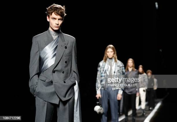 Models present creations by Dior during the men's Fall/Winter 2019/2020 collection fashion show in Paris on January 18 2019