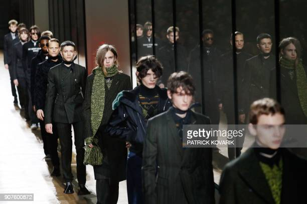 Models present creations by Dior during the men's Fashion Week for the Fall/Winter 2018/2019 collection in Paris on January 20 2018 / AFP PHOTO /...
