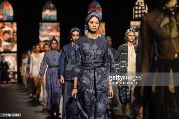 Models present creations by Dior during the Paris Fashion Week's Women Spring Summer 2021 ready-to-wear fashion show in Paris, on September 29, 2020.